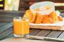 ¿Puede mi perro tomar jugo de naranja?
